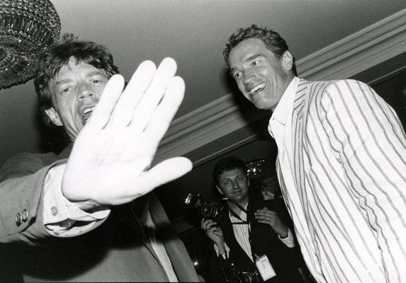 Mick Jagger with Arnold Schwarzenegger. In the back Richard Blanshard