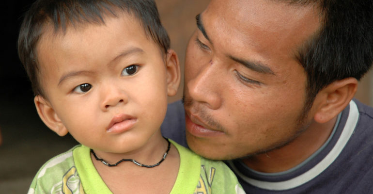 Burmese migrant with a son
